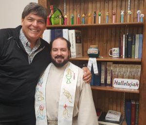 With Pastor Adam Demetros; note the 'Sensational Sermons' award on the shelf. Very appropriate!